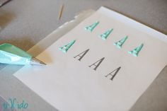 How to make letters. Print them first, put wax paper over, pipe and let dry. Then transfer. Brilliant.
