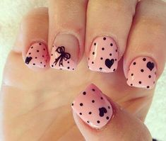 Pleasing and cute nail art with polka dots, hearts and a bow