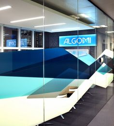 alelo elopar group office photo featuring glass graphics glass walls media recessed lighting small meeting room wood floor alelo elopar group offices sao paulo
