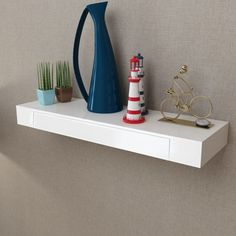 This wall display shelf will become the focal point of your home. With an invisible mounting system, this wall shelf is easy to install and serves as the perfect place to store the items such as awards, books, collectables, ornaments, etc. It has a drawer for small items like keys, DVDs, notepads, pens, and other knick-knacks. This display shelf will suit any decor and turn an empty wall into a feature! This hanging shelf is made of high-quality MDF with a matte finish. Delivery includes 1 wall Wall Shelf With Drawer, Corner Wall Shelves, Drawer Shelves, Shelves In Bedroom, Hanging Shelves, Display Shelves, Floating Shelf With Drawer, Wood Floating Shelves, Wood Shelves