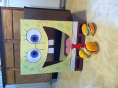 """Cheap Spongebob party idea! I made this from a cardboard box, poster board, construction paper, markers, and glue. I bought the """"crabby patties"""" at the dollar tree in the dog toy section. Toss the patties in his mouth!"""