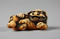 Netsuke of Reclining Dog, 19th century. Japan. The Metropolitan Museum of Art, New York. Gift of Mrs. Russell Sage, 1910 (10.211.1098) #dogs
