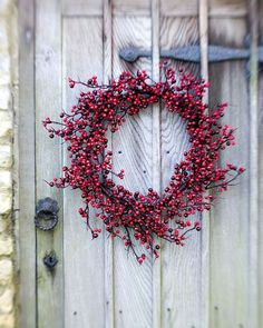 berry wreath on a weathered door