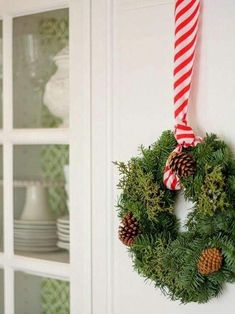 Five Ways to Decorate With Wreaths - A Thoughtful Place hung with ribbon and taped to back of door. Cottage Christmas, Christmas Kitchen, Cozy Christmas, Christmas Candy, Beautiful Christmas, Christmas Holidays, Christmas Wreaths, Christmas Decorations, Coastal Christmas