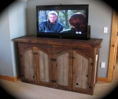 barnwood salvage unique furniture this rustic barn wood cabinet features a remote controlled tv lift