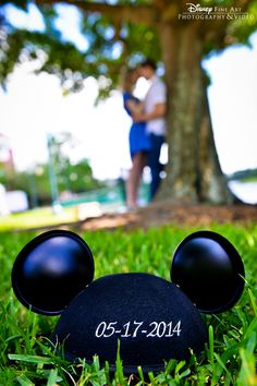 Engagement shoot at Walt Disney World Resort featuring the couple and embroidered wedding date Mickey Mouse ears