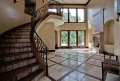 tuscan style interior entrance | Classic details complement the beautiful wood and marble floor placed ...