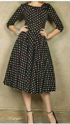 Black polka dot swing dress