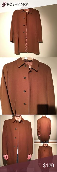 "Jos. A. Bank Executive Collection 3/4 Topcoat 3/4 length brown topcoat. Color is chestnut. Traditional fit. Single-breasted button front. Buttons are covered when closed. Center vent. Side pockets. Worn a few times and in excellent condition. Left pocket has a hole inside. Can approx. fit 2 fingers through it. Approximately 36 1/2"" long. Approximately 23"" from armpit to armpit. 100% wool Jos. A. Bank Jackets & Coats"
