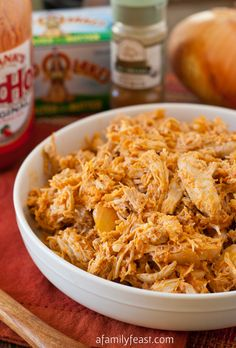 Slow-Cooker Pulled Buffalo Chicken - A Family Feast  -----  White & Dark Chicken, onion, cumin, hot sauce