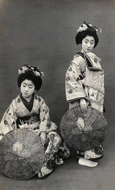 Geiko Tokiko and Friend 1920s  Geiko Tokiko (standing on the right) in costume for the Miyako Odori (Cherry Dance). Tokiko first appeared in the 1917 Miyako Odori programme as a maiko (apprentice geisha) and last appeared in the 1926 programme as a geiko (geisha). By 1928 a new maiko appeared under the name Tokiko.