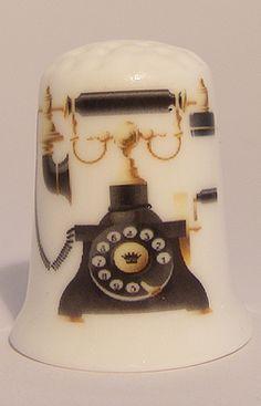 Old phone porcelain thimble These are for sale by https://www.speelgoedenverzamelshop.nl/vingerhoedjes/algemeen/oud_telefoon_bedrukt_porselein_vingerhoedje_7919.html