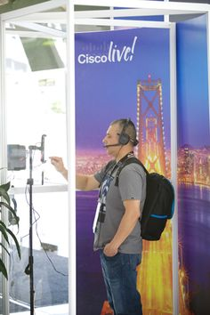 "In the social media hub, guests could enter a recording booth to share their thoughts on the event and to answer questions such as ""How will the future be different?"" Organizers posted the videos on the Cisco Live YouTube channel and also created a montage that was shown at the closing general session. Participants received a copy of their recordings via email and also were entered in a drawing for a T-shirt.  Photo: Steve Maller Photography"