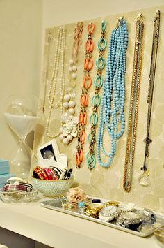 Jewelry organization for closet.  Cover foam board with pretty paper or fabric and hang necklaces on pushpins.