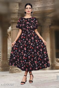 Checkout this latest Dresses Product Name: *Printed Black Calf-Length Crepe Dress* Fabric: Crepe Sleeve Length: Short Sleeves Pattern: Printed Multipack: 1 Sizes: S, M (Bust Size: 38 in, Length Size: 50 in)  L (Bust Size: 40 in, Length Size: 50 in)  XL (Bust Size: 42 in, Length Size: 50 in)  XXL (Bust Size: 44 in, Length Size: 50 in)  Country of Origin: India Easy Returns Available In Case Of Any Issue   Catalog Rating: ★4 (1598)  Catalog Name: Chitrarekha Fashionable American Crepe Women'S Dresses CatalogID_763467 C79-SC1025 Code: 923-5166321-828