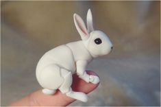 Realistic articulated doll (BJD) - Bunny. 3/4/5 cm in back. Color white.    Doll assembled on elastic beading 0.6mm thick. The muzzle is mounted on
