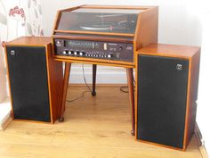 via Retro To Go, nice wooden stereo furniture.