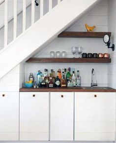 Wet Bar under stairs. Wet Bar under staircase. Built in wet bar under the stairs with floating shelves and shiplap cabinets and shiplap paneling. Wet Bar under the stairs Jennifer Worts Design Inc Bar Under Stairs, Kitchen Under Stairs, Space Under Stairs, Shelves Under Stairs, Bar Shelves, Cabinet Under Stairs, Staircase Storage, Stair Storage, Staircase Design