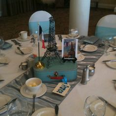 Instead of table numbers, have each table decorated after a famous country or city.