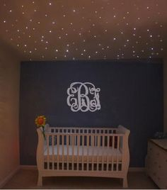 Baby girl nursery with a display of stars via optic fiber ceiling lights