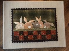 Wool applique  pattern called Carrot Patch by SusanGonzalesDesigns