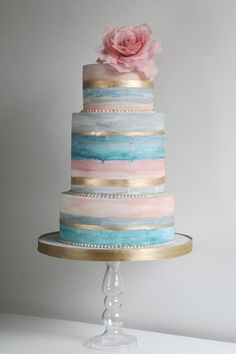 """Soft washed"" pink, light blue, aqua, and gold striped wedding cake with oversized gum paste rose topper."
