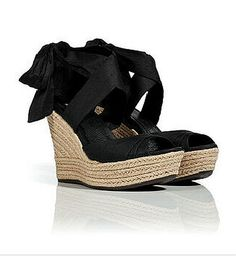 Ugg Black Leather Silk Lucianna Wedges    —     The classic espadrille gets a high style kick with this black silk-detailed version from UGG Australia* Open toe, silk and suede upper with crisscross strap detail, woven wedge platform, rubber sole