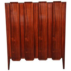 Borsani Rosewood Cabinet, Made in Milan, 1950s | From a unique collection of antique and modern cabinets at https://www.1stdibs.com/furniture/storage-case-pieces/cabinets/ | $13,500