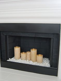 """Candles in the Fireplace - especially """"wood wick"""" candles, as they actually """"Crackle"""". Great option if your fireplace is non functional, you have """"spare the air"""" days as we do, or f(Diy Candles Design) Empty Fireplace Ideas, Unused Fireplace, Candles In Fireplace, Fireplace Inserts, Fireplace Glass Rocks, Fake Fireplace Mantel, Artificial Fireplace, Craftsman Fireplace, Decorative Fireplace"""