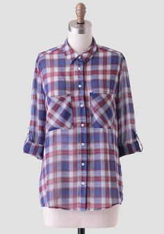 This sheer chiffon blouse features a classic red, light-blue, and white plaid pattern, front button closures, and two large front pockets. Perfected with optional roll-tab sleeves and a slight hi...