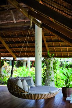 Dedon Island - A hanging chair in an open-air pavilion, perfect for naps during rainy days. love the wood floors too.
