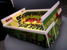 A paper tray our CEO made from the yard signs our screen printers do test prints on.