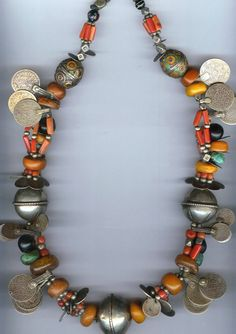 An attractive and wearable necklace from Tiznit in Morocco, featuring a mixture of materials such as silver (coins and beads, some enamelled), amber, coral, amazonite, and jet. Shown by, and available for purchase from, Singkiang: info@singkiang.com.