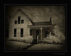 Villisca Ax Murders House 8 people were bludgeoned to death with an ax while they slept. 6 of them were children. 2 were neighbor children. 4 were killed in the room upstairs where the three windows are.The parents room there is still a mark in the wall from the swing of the ax