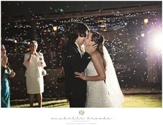 Bride and groom kissing in bubbles. Chelsea + Daniel's wedding at Lenora's Legacy Estate. Image credit: Michelle Brooks.