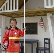 """The Five Alarm Firehouse features a standing red asphalt shingle roof, realistic barn-style """"truck"""" doors, and operable windows. Playhouse Kits, Playhouse Outdoor, Bed Nook, Wendy House, Asphalt Roof Shingles, Play Houses, Kids Playing, Pretend City, Style"""