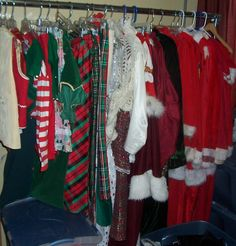 We have a whole rack of Christmas attire with bins of accessories like Santa belts, shoes, hats and elf pieces below Christmas Costumes, Christmas Stockings, Office Christmas Party, Elf, Santa, Holiday Decor, Accessories, Shoes, Collection
