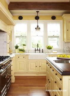 Yellow kitchen will be so much attractive for any home design whether big or small. It gives your room a bright color and more spacious. So, here are some yellow kitchen ideas for designing your kitchen room. Yellow Kitchen Cabinets, Kitchen Cabinet Colors, Painting Kitchen Cabinets, Kitchen Colors, Kitchen Yellow, Yellow Kitchens, White Cabinets, Diy Cabinets, Cream Cabinets