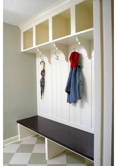 place for kids to hang backpacks, cabinetry open to floor for shoes. traditional entry by Ron Brenner Architects