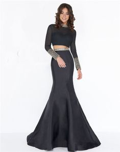 Be bold in this exquisite black two-piece gown! The novelty mesh features a high neck beaded collar and sleeves with fully beaded cuffs. The same beading motif is adorned to the full mikado trumpet skirt. Mermaid Evening Dresses, Evening Gowns, Prom Dress Stores, Prom Dresses, Ball Dresses, Trumpet Gown, Trumpet Skirt, Two Piece Gown, Black Two Piece