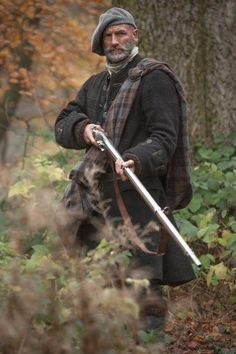Graham McTavish as Dougal Mc Kenzie, Jacobite, with a musket.