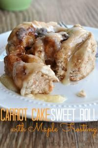 Carrot Cake Sweet Rolls on MyRecipeMagic.com are made with a carrot cake mix, loaded with raisins and topped with maple cream cheese frosting! YUM
