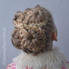 Quadruple starburst bun by Jenni's Hairdays. Inspired by Abella's braids