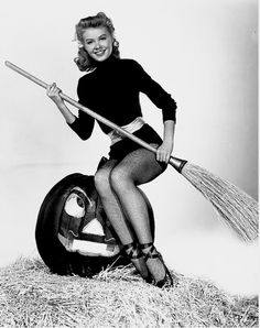 """""""That's right Mr. Jack-O-Lantern keep talkin' smack and when this photo shoot is over I'm gonna show you exactly what this broom stick is capable of doing!"""""""