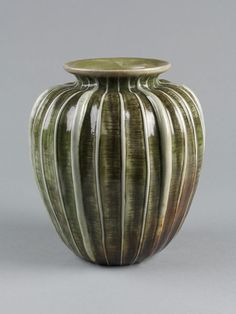Martin Brothers Pottery - Ribbed Vase. Modelled, Incised & Glazed Stoneware. Southall, Middlesex, England. Circa 1900.