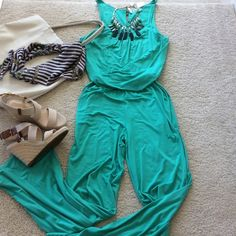 """Daven Jersey Jumpsuit Super cute and flattering Daven jersey jumpsuit. Gorgeous teal color. One piece. The top blouses over the banded waistband. Spaghetti straps, scooped neckline with slight gathering at the bust to help created the flowing effect. The bottom /pants portion are loose and flows with wider ankles. Fabulous with tall chunky wedges. Side pockets. Laying flat approx 21"""" shoulder to waistband, approx 44"""" waistband to ankle. 95 rayon 5 spandex. Size M. NWT, never worn. Daven…"""