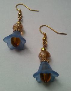 Check out this item in my Etsy shop https://www.etsy.com/listing/250618103/blue-flower-dangle-earring-with-brown