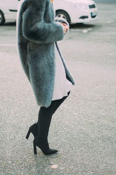 Faux fur, pleats, and over-the-knee boots.