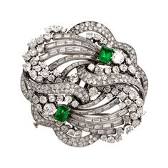 1930s Boucheron Paris  Emerald Diamond Platinum Double Clip  Brooch | From a unique collection of vintage brooches at https://www.1stdibs.com/jewelry/brooches/brooches/