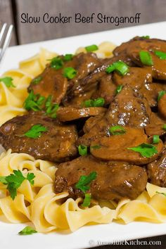 This recipe for Slow Cooker Beef Stroganoff is by far one of the best beef stroganoff recipes I've ever made. Fork tender beef in a rich savoury gravy!